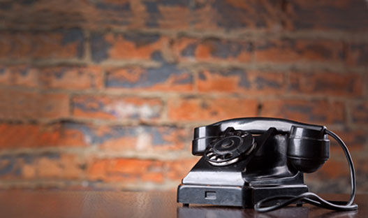 Contact Us - Rotary telephone on a desk